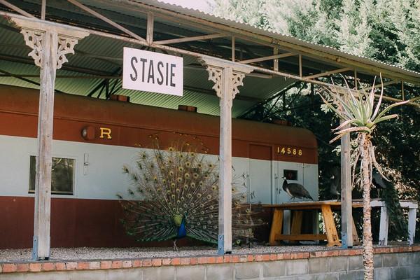 Peacock on train platform at The Simondium Country Lodge