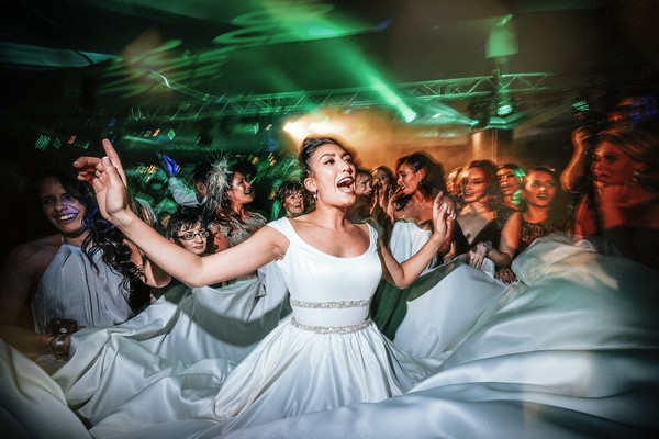 Bride singing on dance floor at wedding