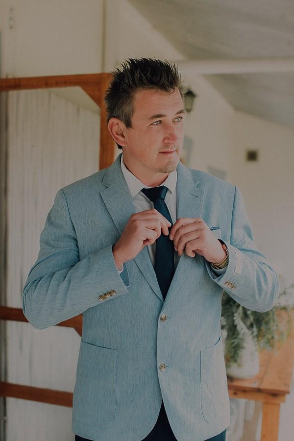 Groom wearing light blue jacket