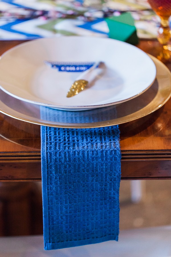 Blue wedding table runner under plate