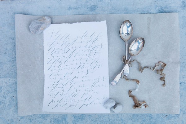 Calligraphy written note with silver spoons