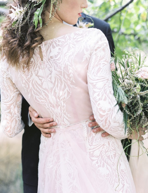 Detail on back of bride's lace wedding dress