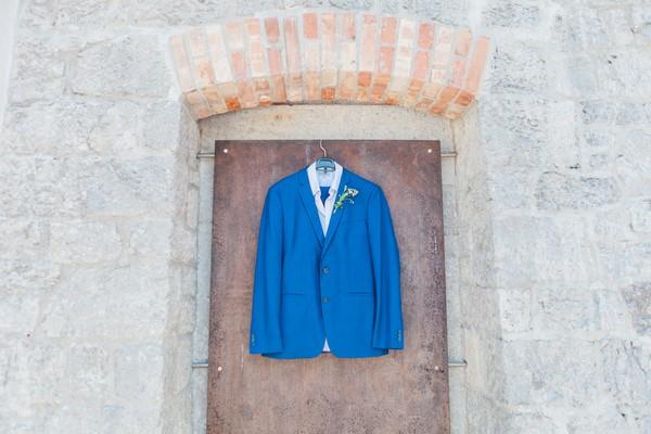 Blue Ted Baker suit jacket hanging on door