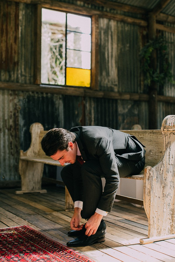 Groom tying shoelace