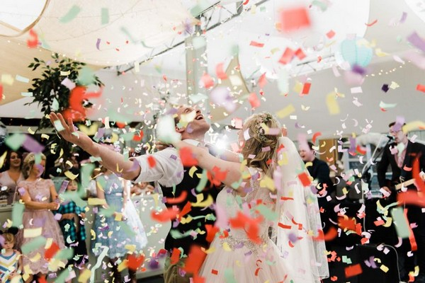 Bride and groom being showered in confetti on the dance floor - Picture by Folega Photography