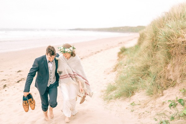 Bride and groom walking on beach - Picture by Matt Ethan Photography