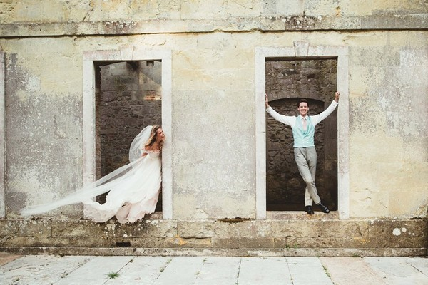 Bride and groom standing in doorways - Picture by Maryanne Weddings
