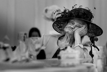 Elderly wedding guest asleep at table - Picture by Photography by Soven