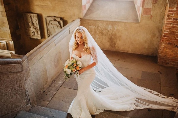Bride walking up stone steps - Picture by Frances Sales Photography