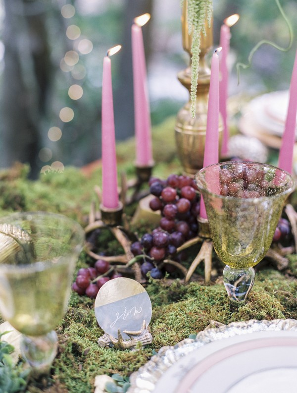 Candles and grapes on wedding table