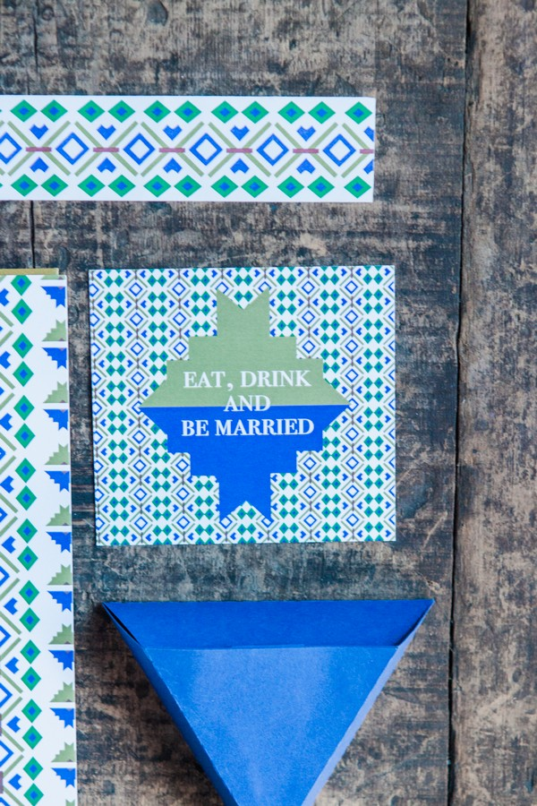 Blue and green geometric wedding stationery