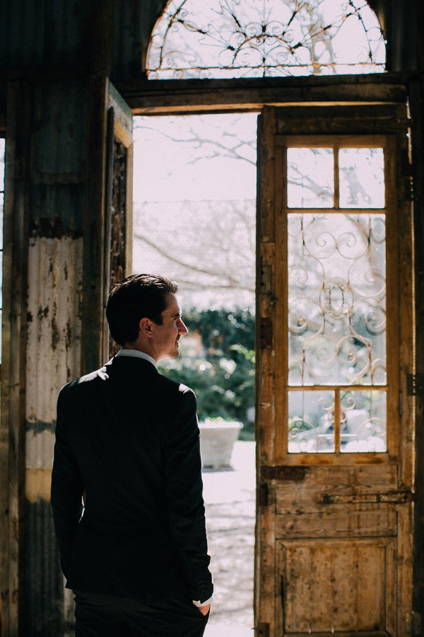 Groom by door of chapel at The Simondium Country Lodge