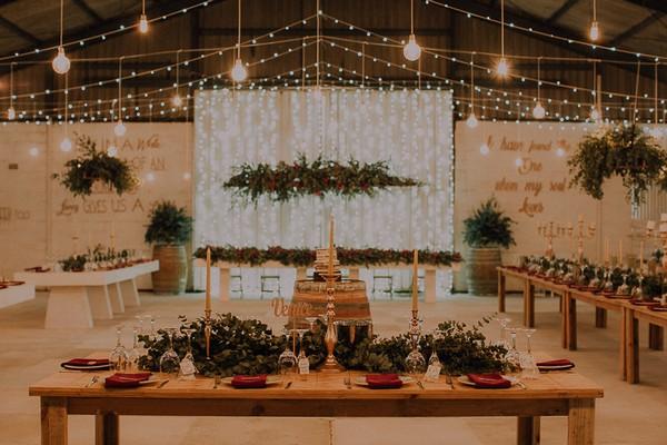 Hanging lighting and wedding tables at Die Stoor
