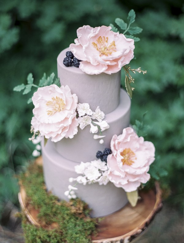 Lavender coloured wedding cake with sugar flowers
