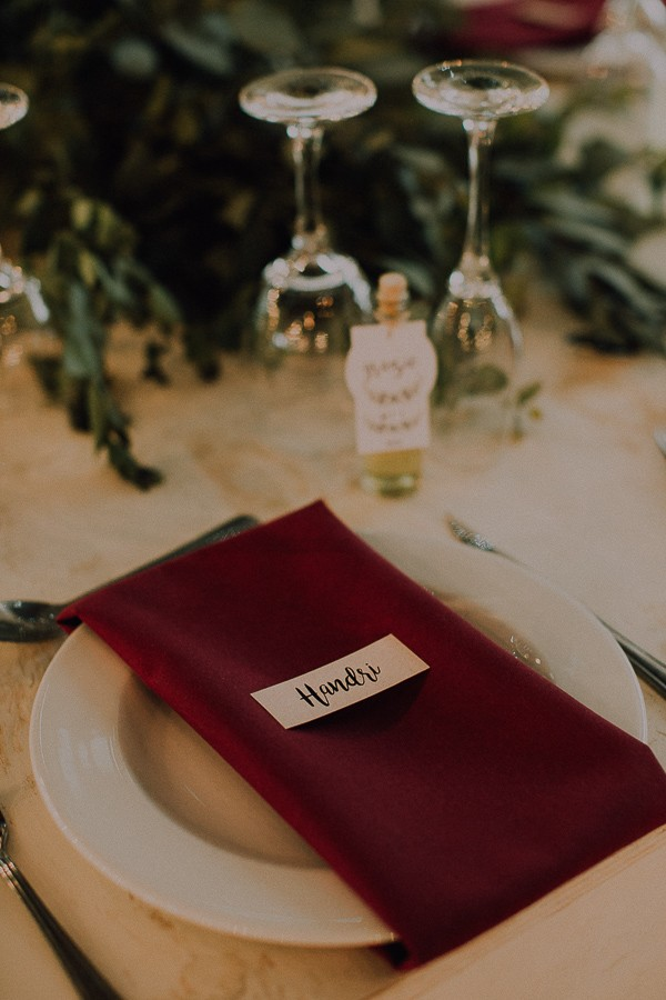 Red winter wedding place setting