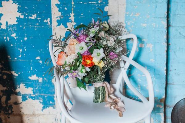 Wedding bouquet on white chair