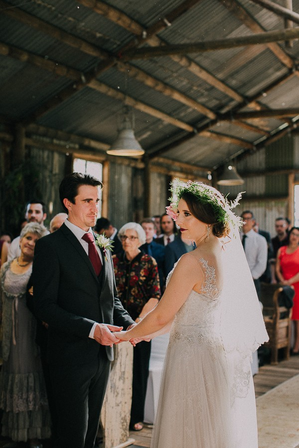 Bride and groom holding hands during wedding ceremony at The Simondium Country Lodge