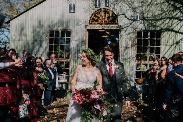 Confetti shot at bride and groom leave wedding ceremony