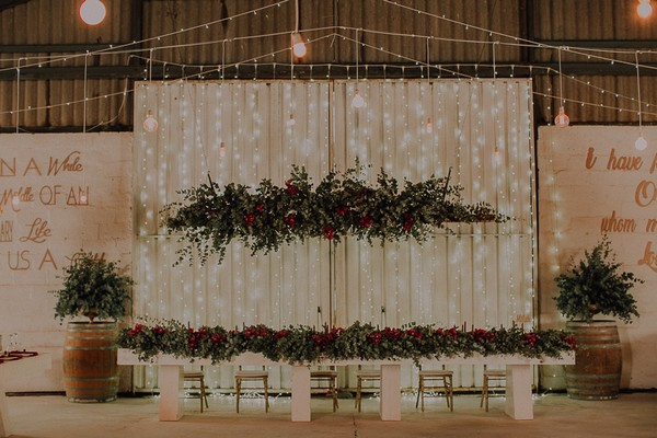 Large foliage hanging installation over wedding top table