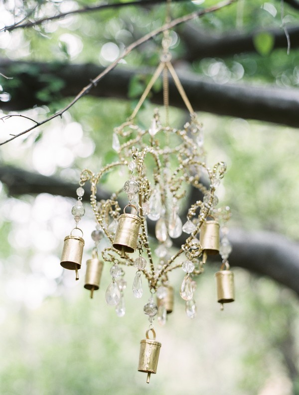 Gold decorations hanging from tree branches
