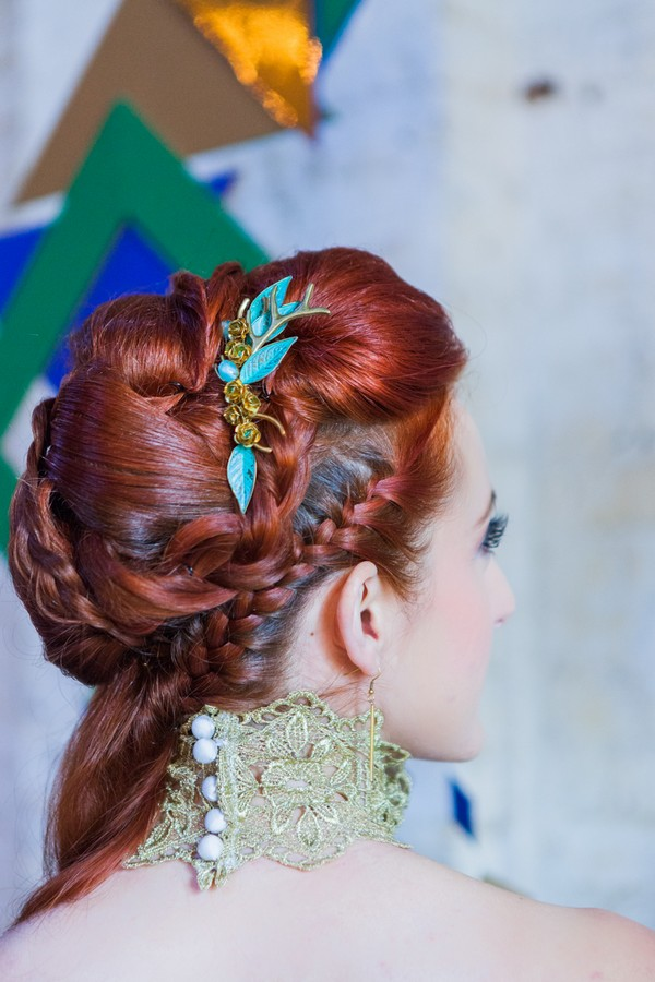 Braid detail and leaf accessory in bride's hair