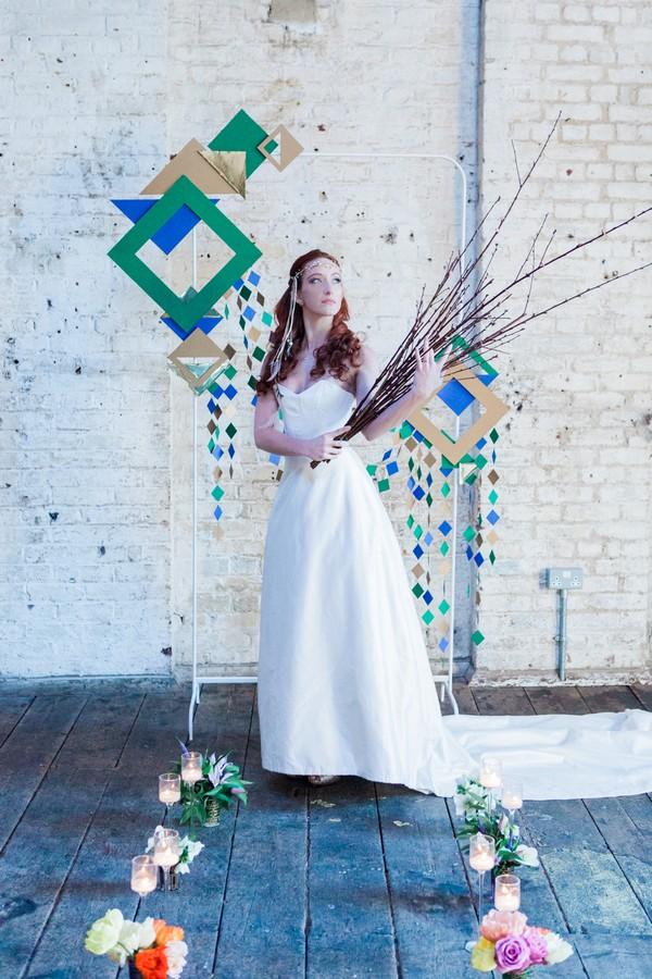 Bride holding twig bouquet