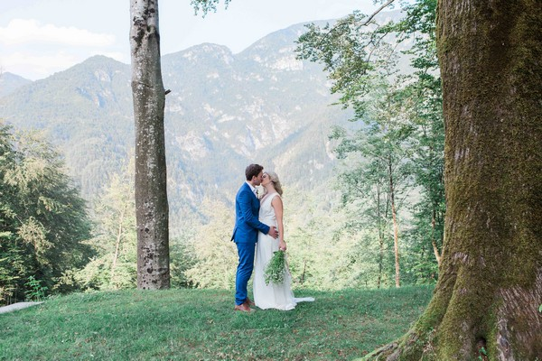 Bride and groom kissing in front of incredible view in Italy