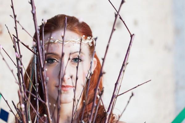 Bride's face behind twigs