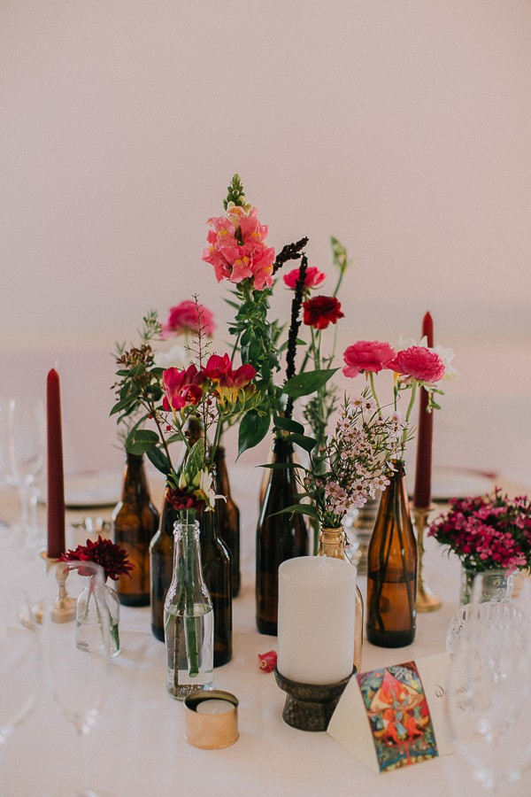 Bottles of flowers on wedding table