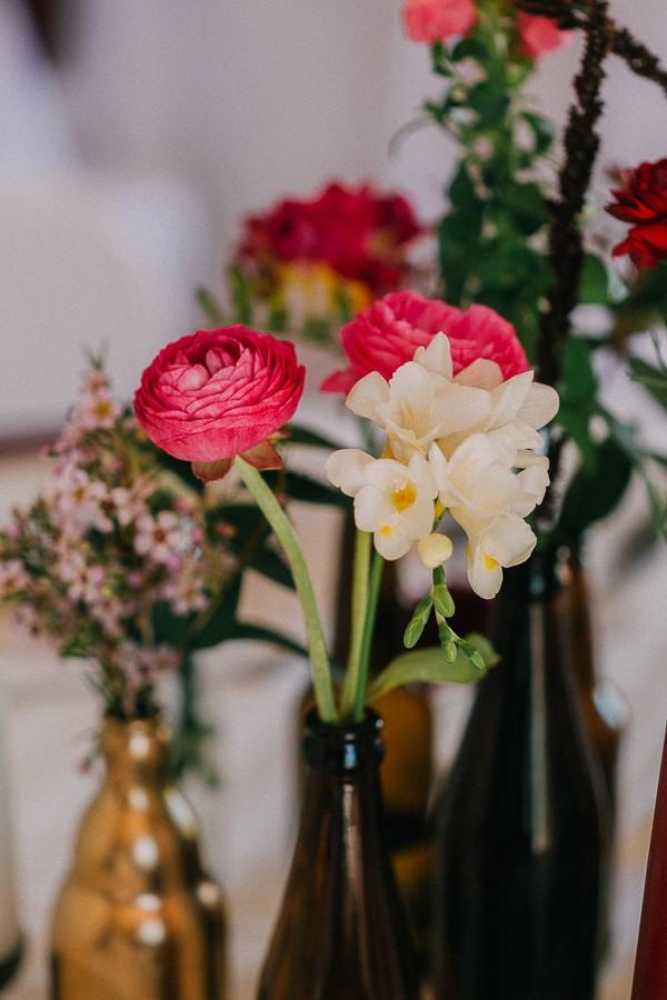 Wedding table flowers in bottle