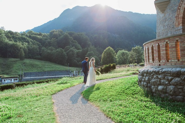 Bride and groom walking in grounds of Count Ceconi Castle in Italy