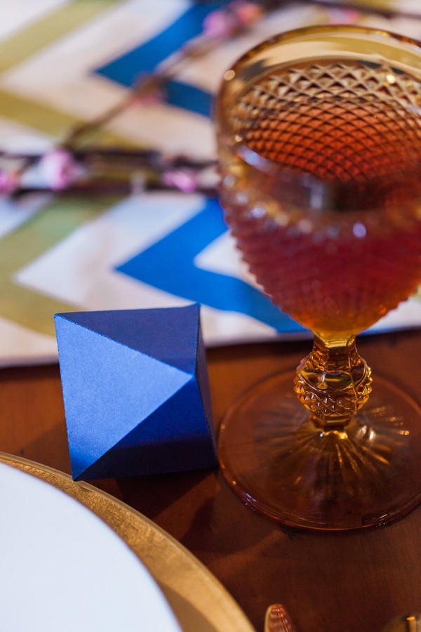 Blue octahedron geometric shape on wedding table