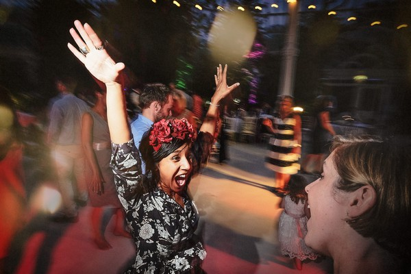 Wedding guest with arms in the air on dance floor