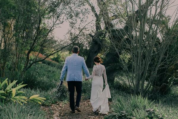 Bride and groom walking holding hands at Langverwagt
