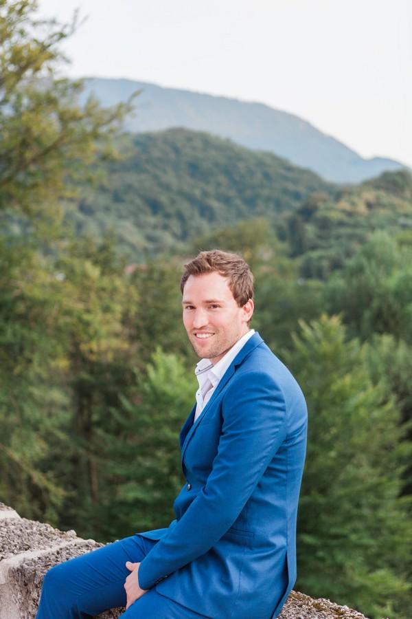 Groom wearing blue suit