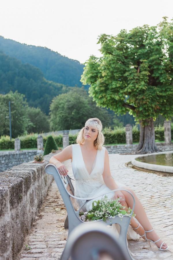 Bride sitting on bench