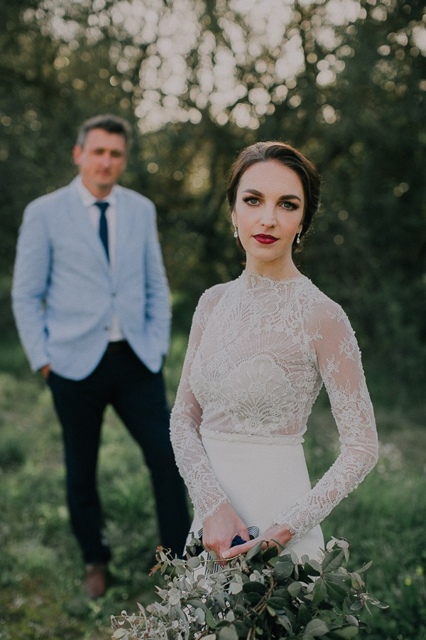 Bride with groom in background