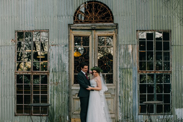 Bride and groom outside doors of chapel at Simondium Country Lodge