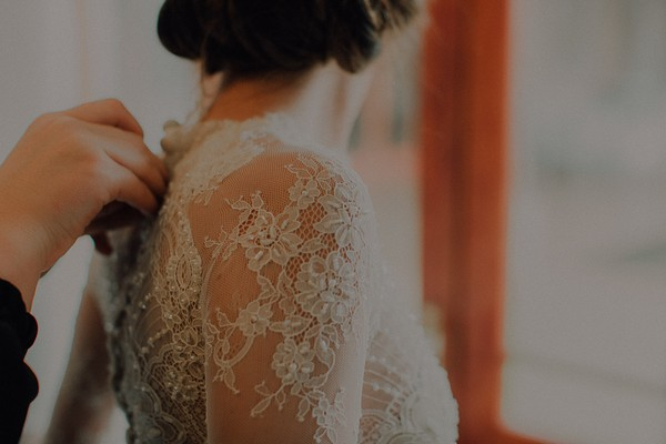 Lace detail on bride's wedding dress