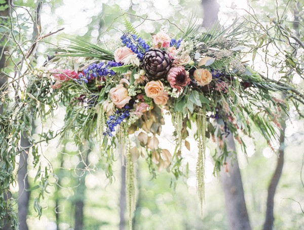 Floral display on wedding ceremony arch