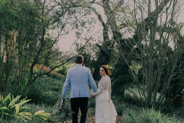 Bride and groom walking in grounds of Langverwagt