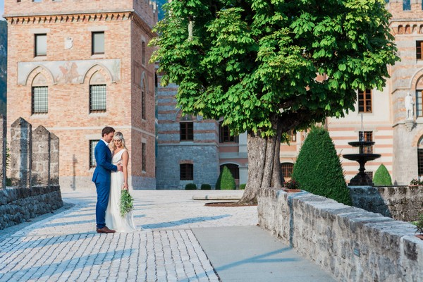 Bride and groom outside Count Ceconi Castle in Italy