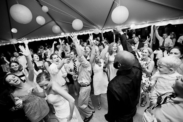 Wedding Guests Dancing with Arms in the Air