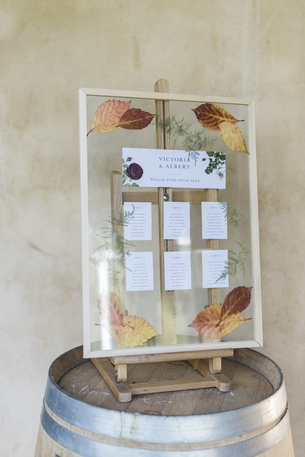 Clear wedding table plan with autumn leaves detail