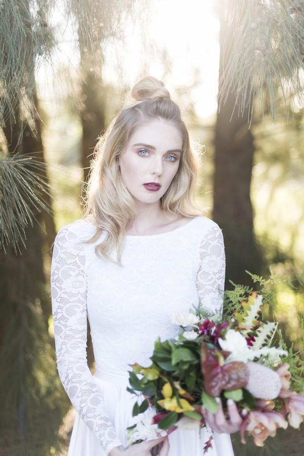Bride with half up half down wedding hairstyle
