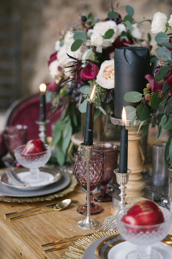 Coloured glass and black candles on wedding table