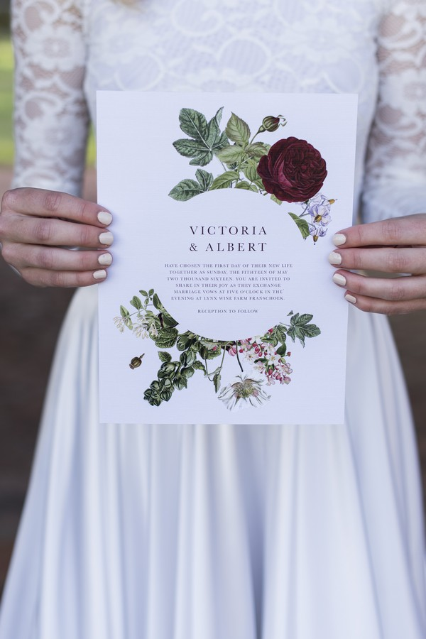 Bride holding winter wedding invitation