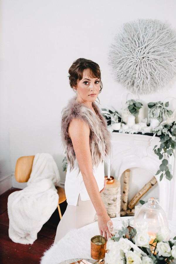 Bride wearing fur and feather shrug