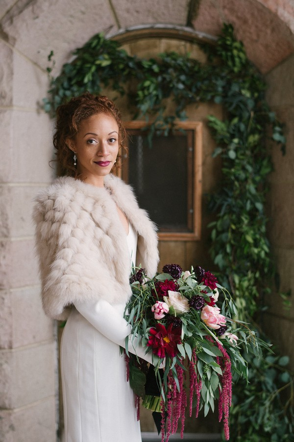 Bride wearing winter fur shrug