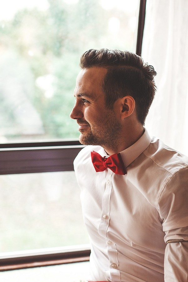 Groom wearing red bow tie